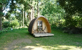 Camping pod in shaded spot