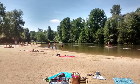 Beach beside river