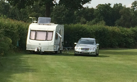 Car and caravan on pitch