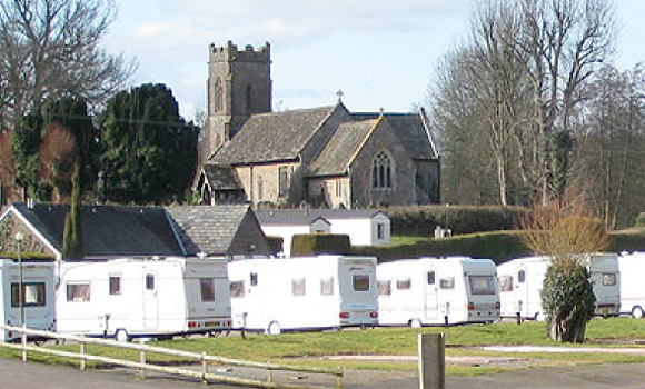 Caravans with church behind